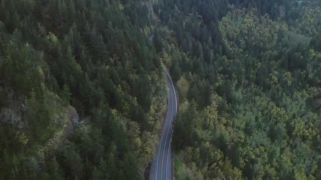 Video of a car traveling on the winding road in the mountains