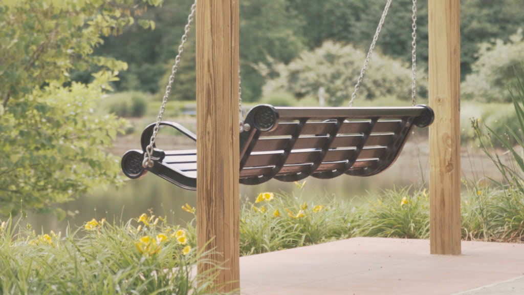 Swinging bench in a park